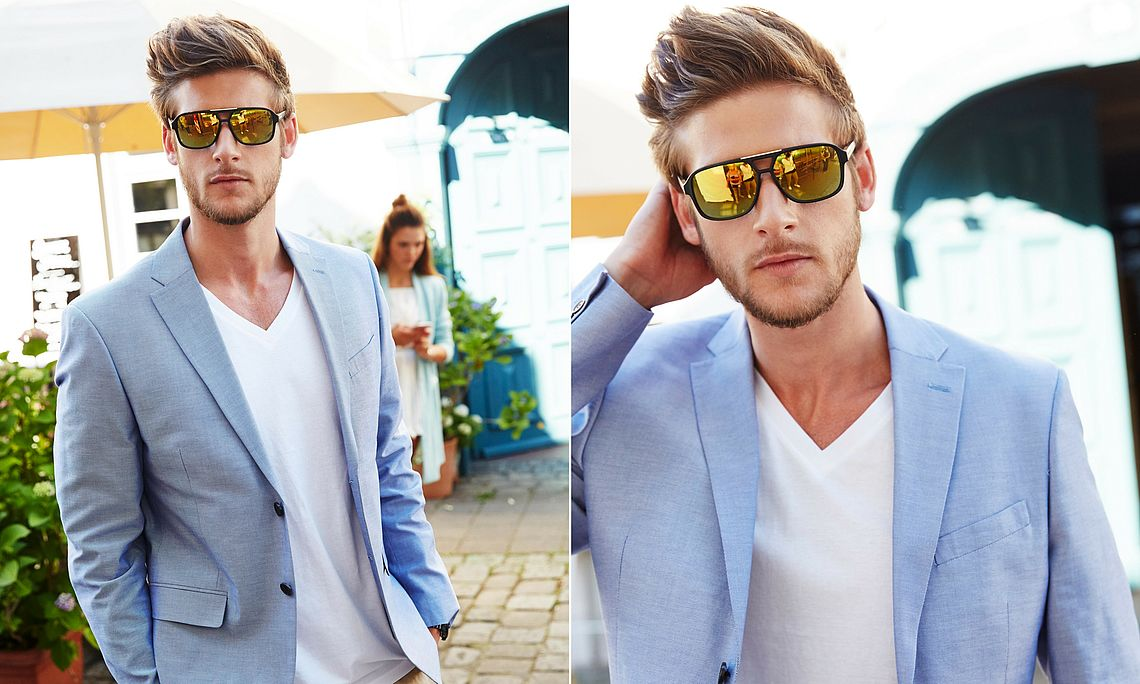 young man wearing mirrored sunglasses