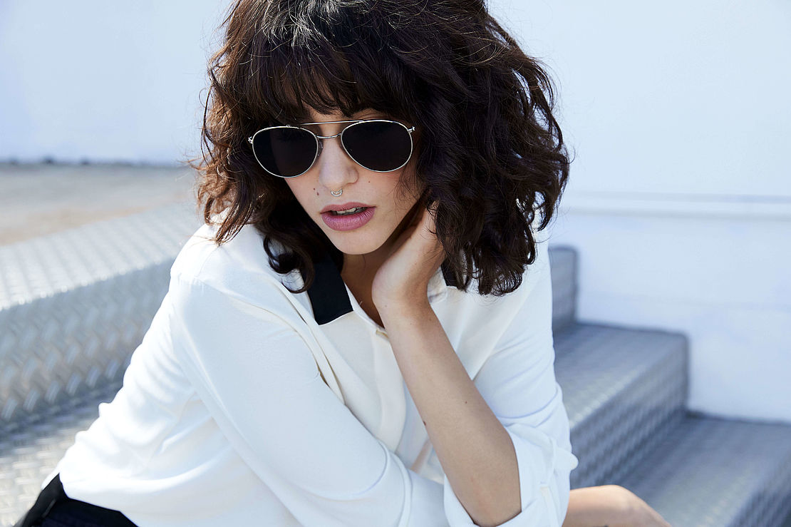 Close-up of woman with small aviator sunglasses style 3021199
