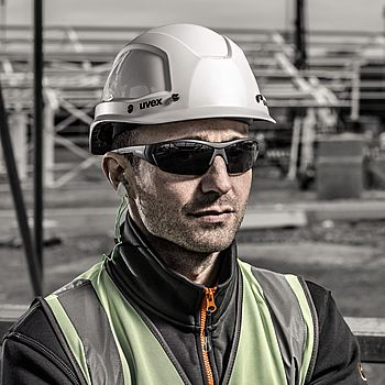 Male worker wearing uvex safety sunglasses