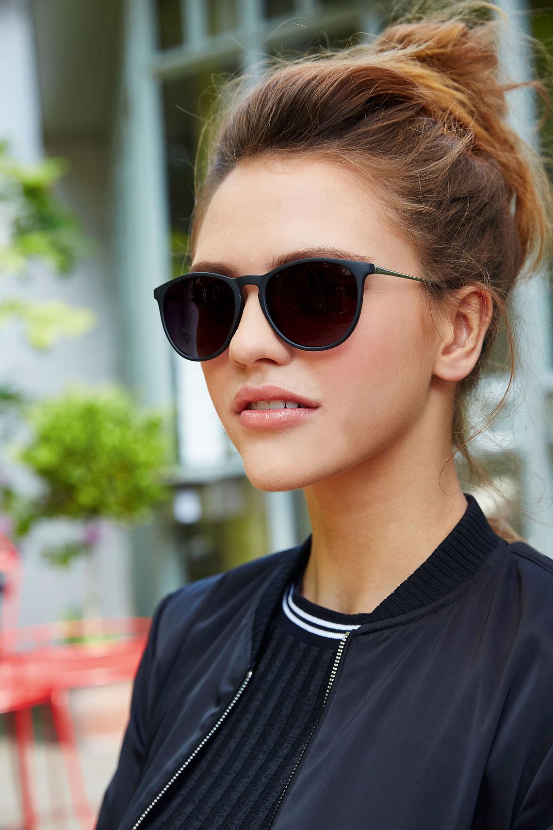 girl wearing panto sunglasses