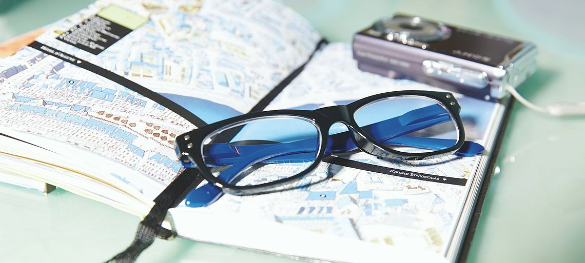 Comfortable reading glasses San Francisco blue on a book
