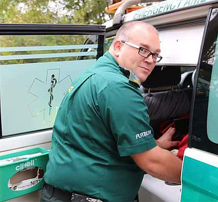 Ambulance technician Scot Grant standing by his emergency vehicle