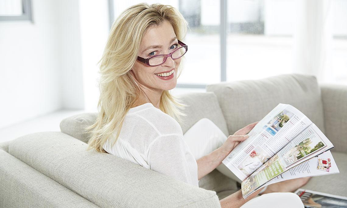 Glasses frame, woman reading magazine