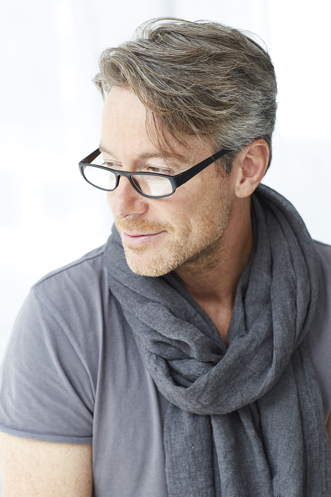 Man wearing reading glasses, colour look black
