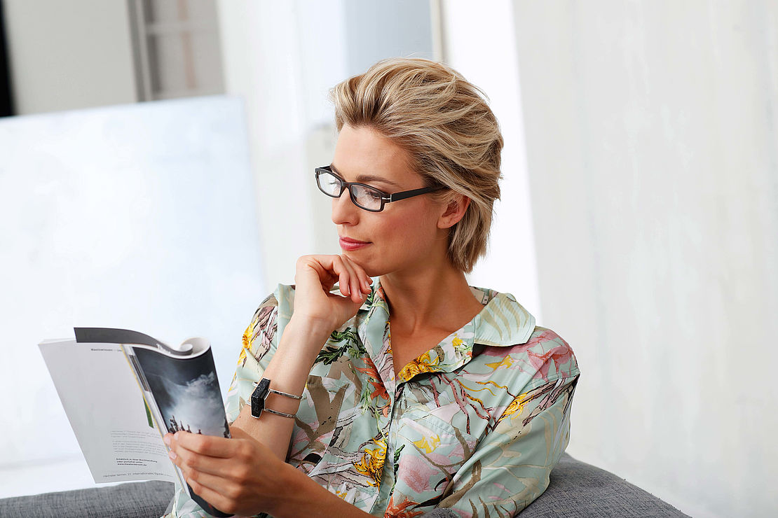 Woman with reading glasses Sydney grey-black