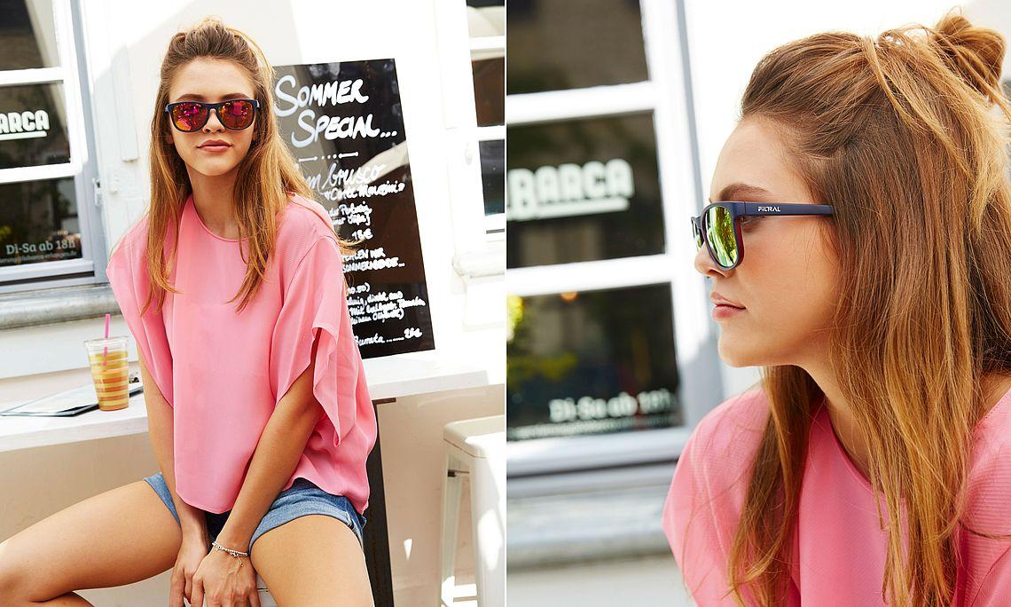 girl wearing mirrored wayfarer sunglasses