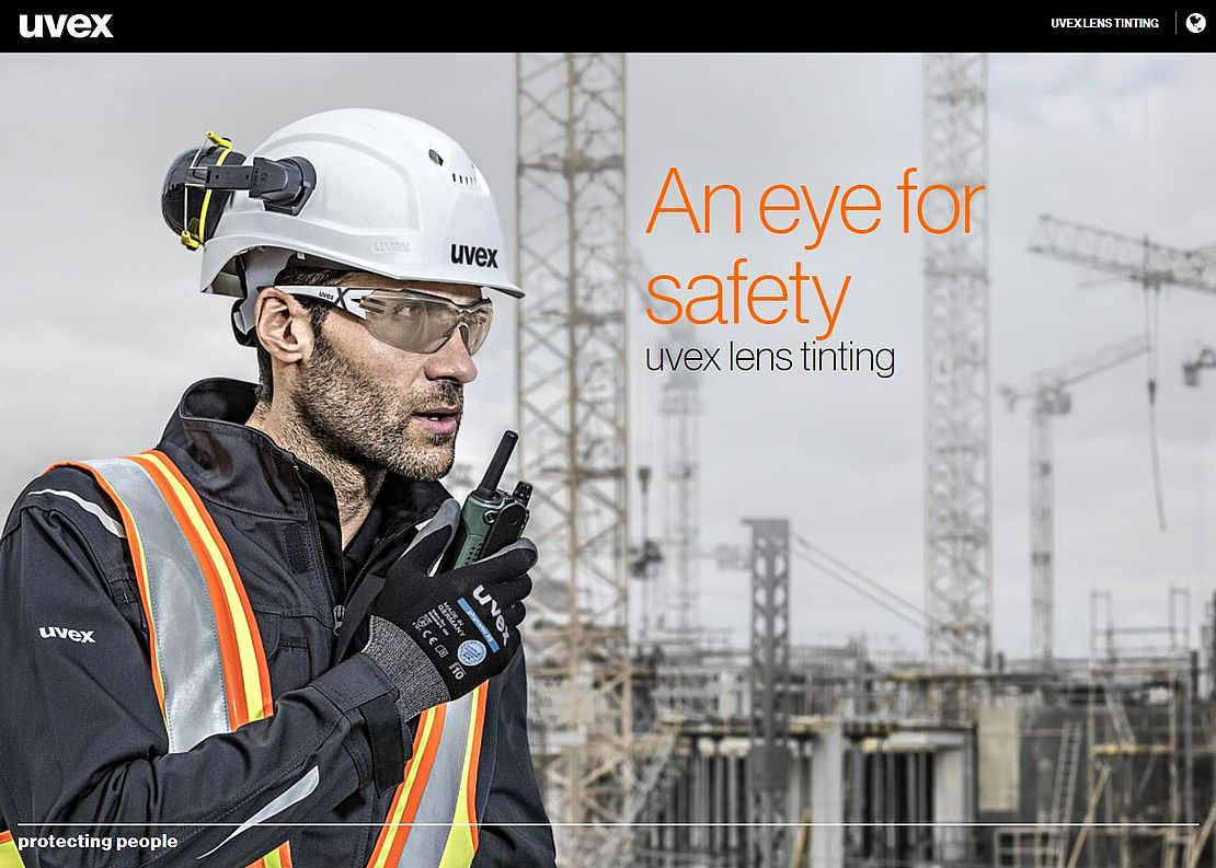 Male worker wearing uvex CBR65 tinted safety glasses