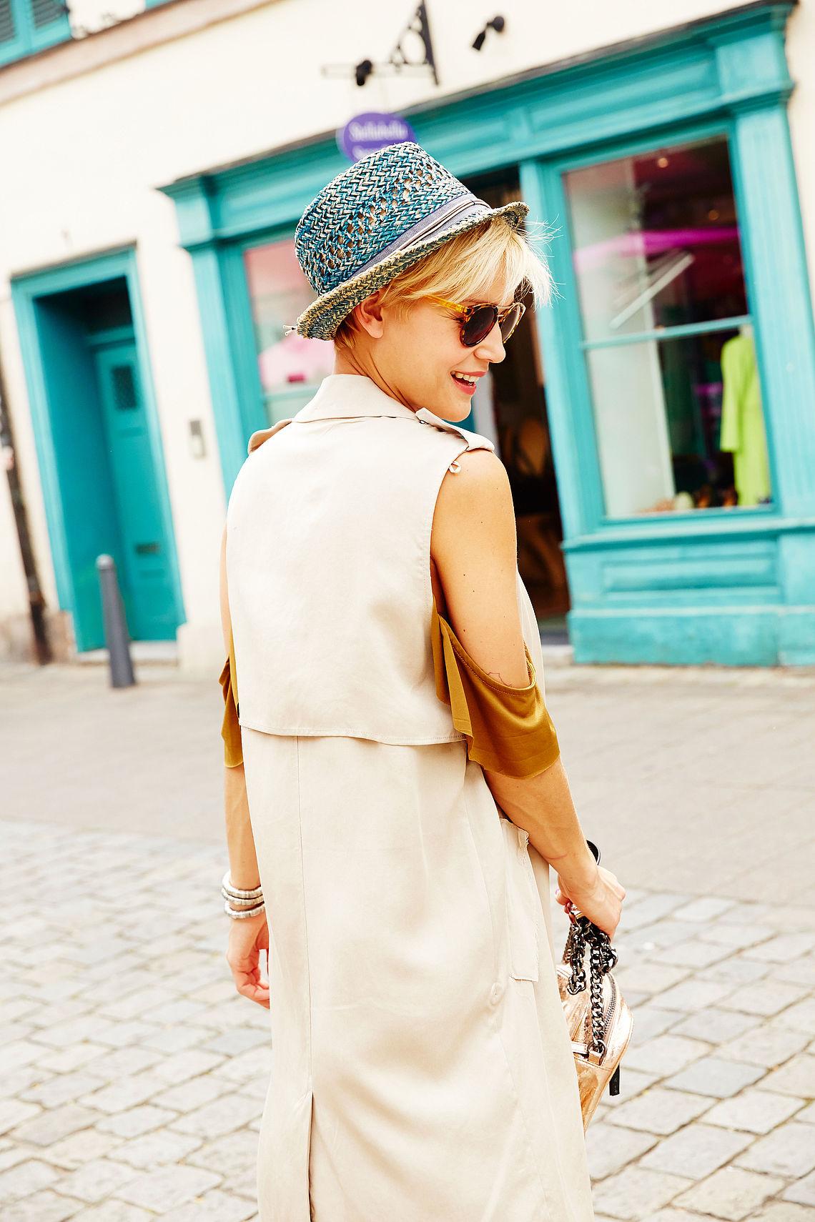 woman outside, wearing sunglasses