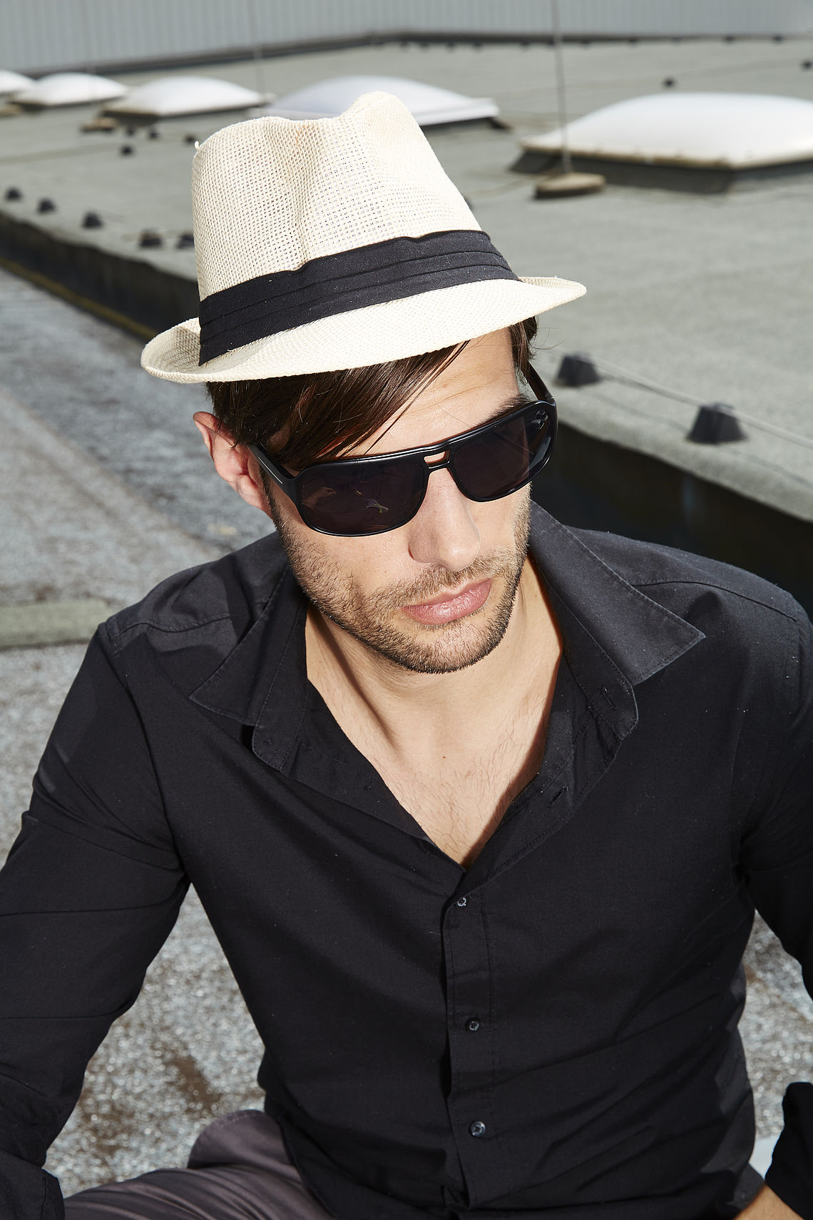 Man on roof with sunglasses