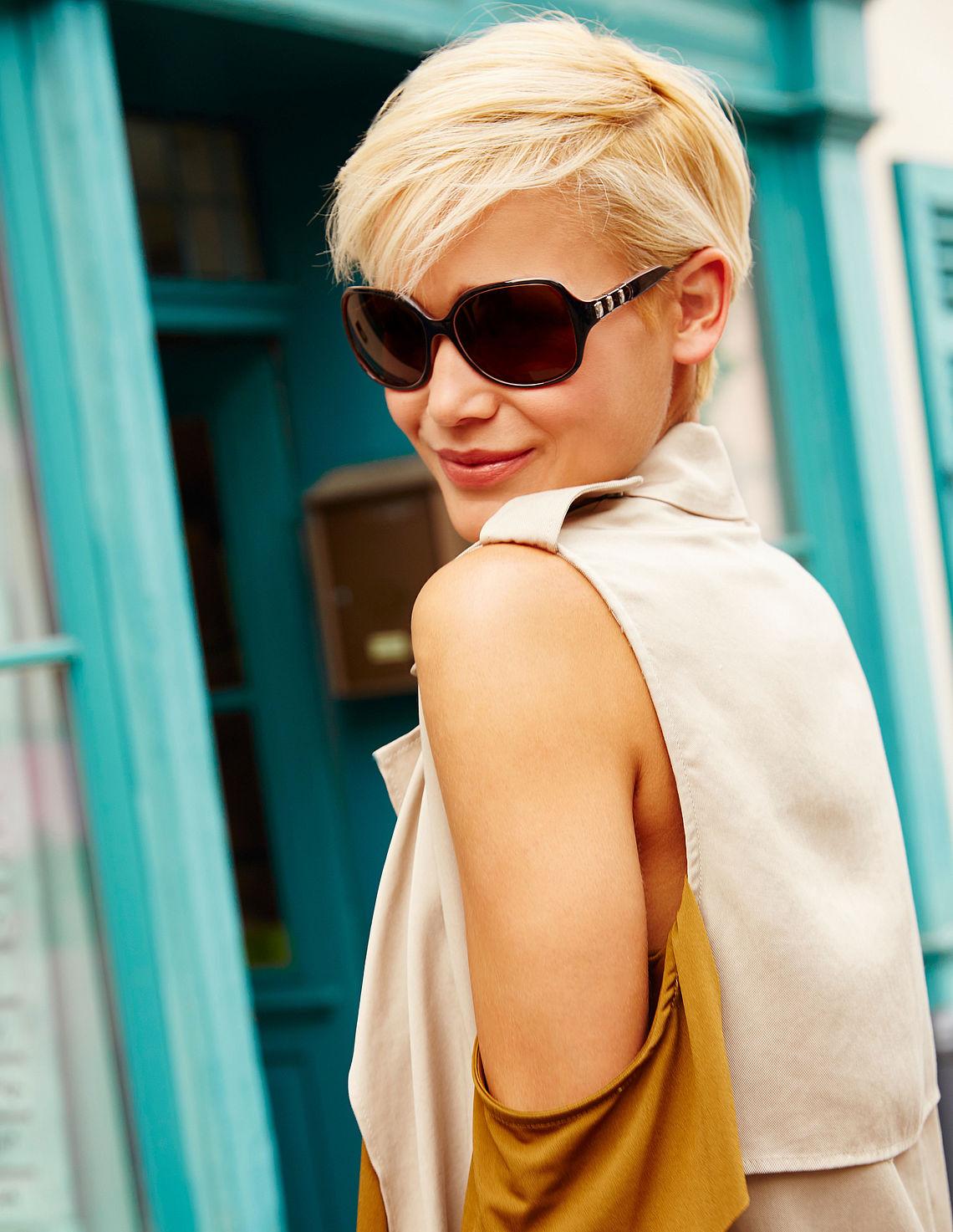 woman wearing polarized butterfly sunglasses