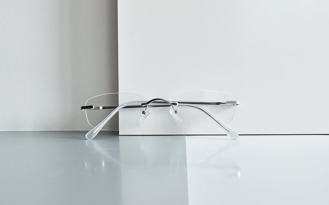 Rimless reading glasses Hamburg silver on glass plate