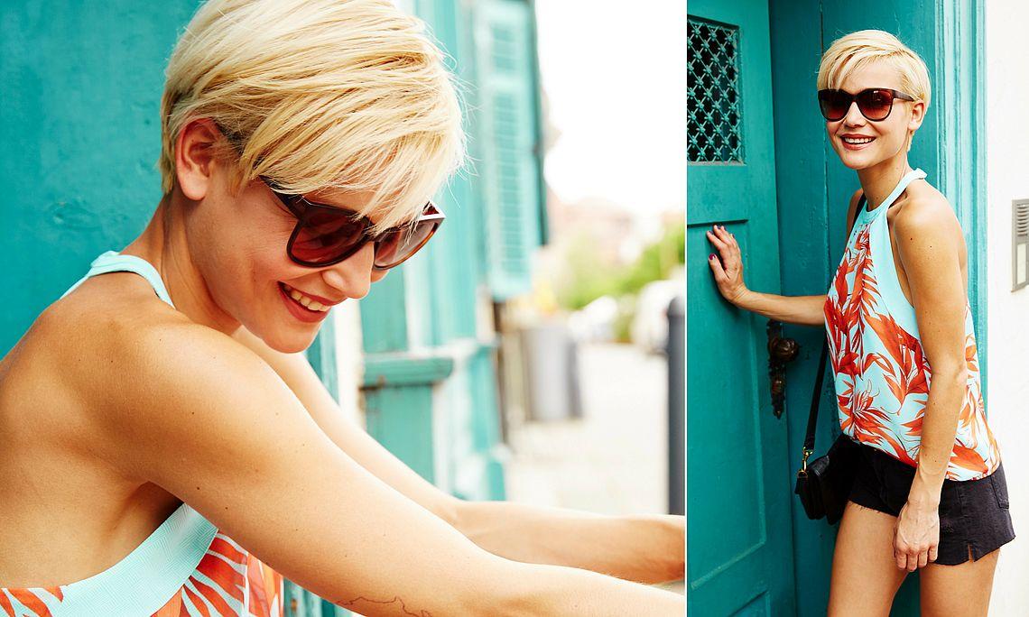 woman wearing butterfly sunglasses