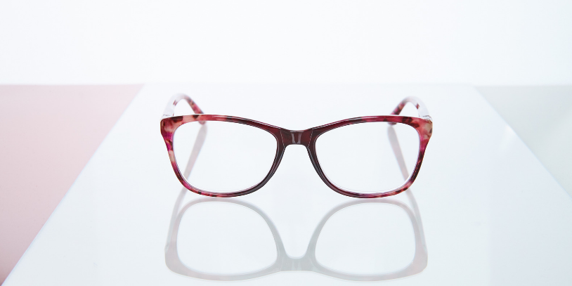 reading glasses tokio red on glass plate