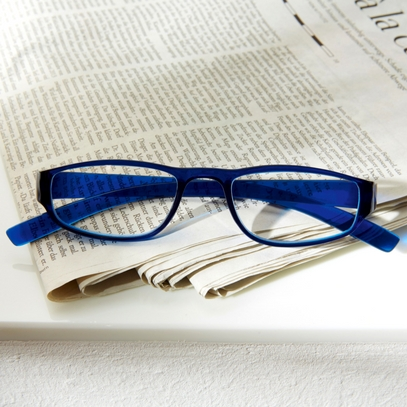 Reading glasses colour look blue, on newspaper