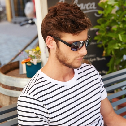 man with aviator sunglasses, sitting on bench