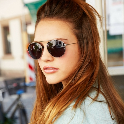 young woman with round sunglasses