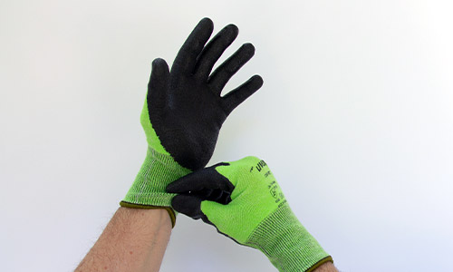 Step 1 in removing uvex gloves safely