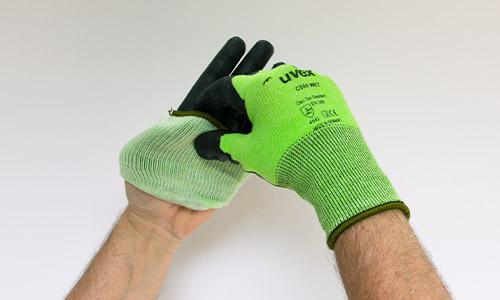 Step 2 in removing uvex gloves safely