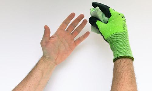 Step 3 in removing uvex gloves safely