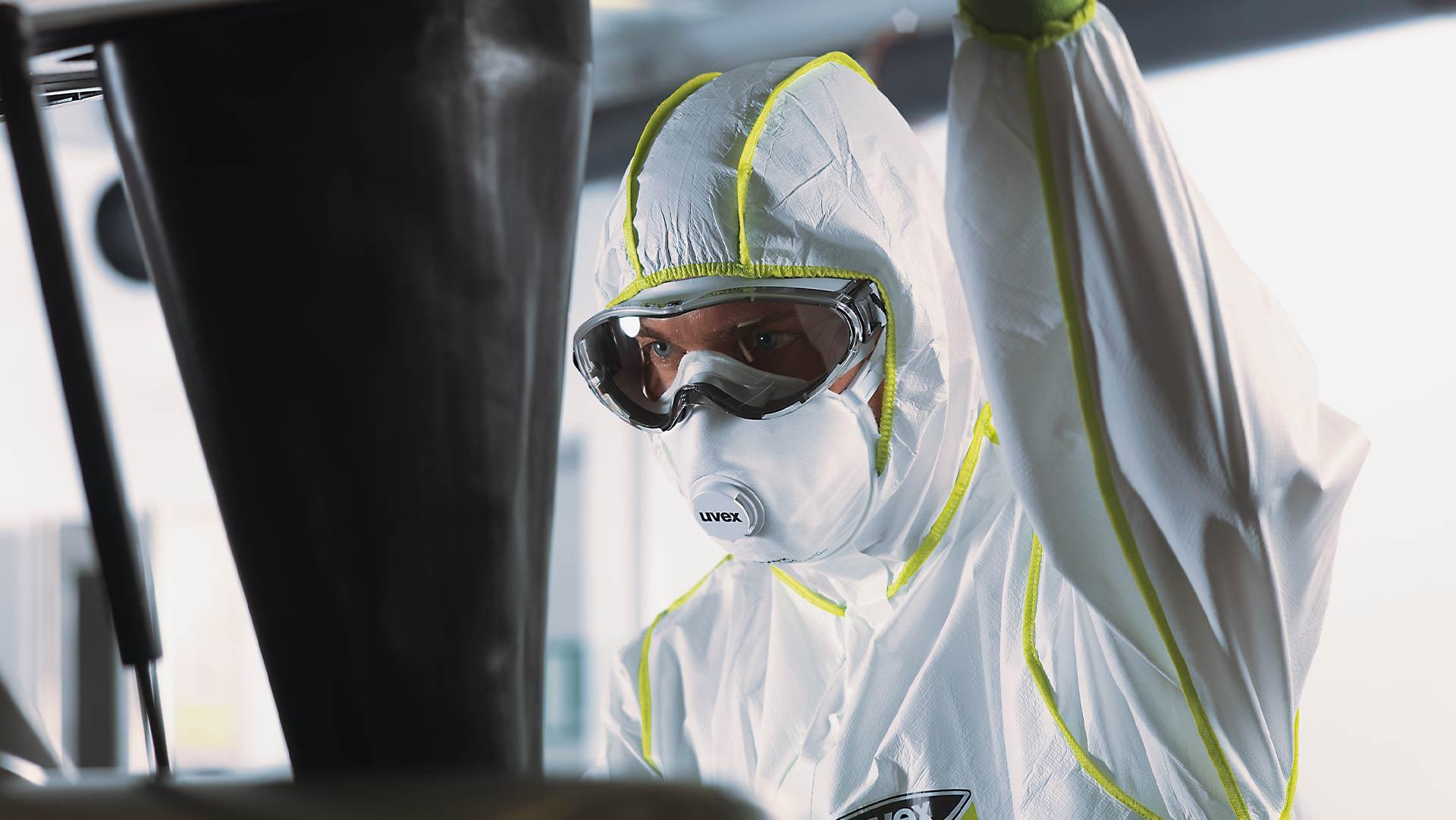 Male employee wearing uvex respiratory mask