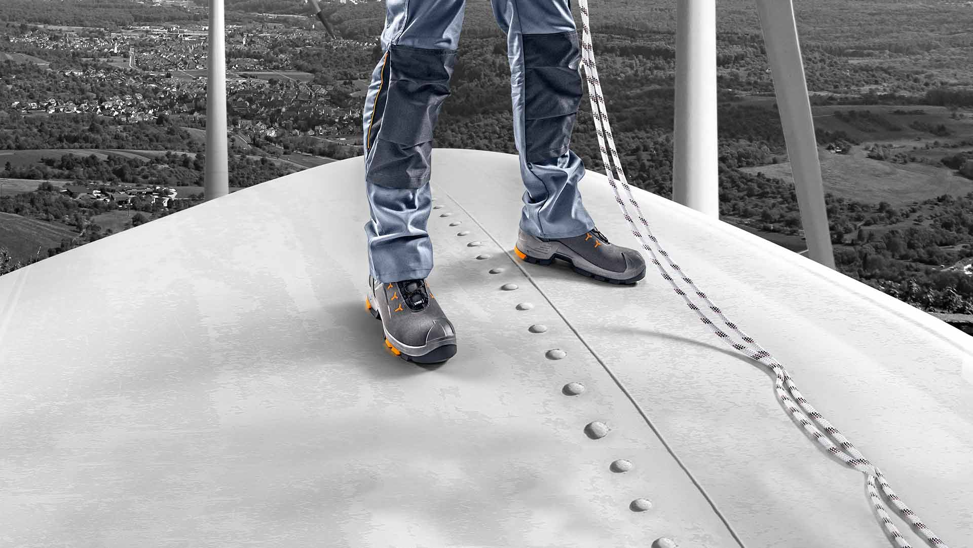 Worker wearing uvex 2 safety boots stood on wind turbine
