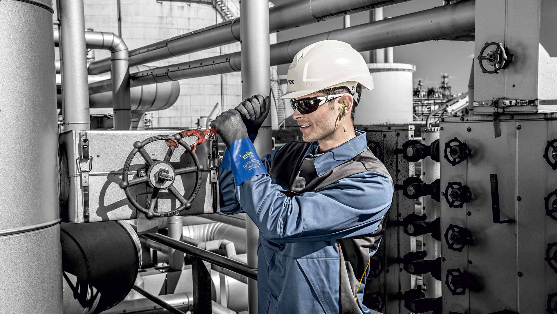 Male employee wearing uvex safety gloves