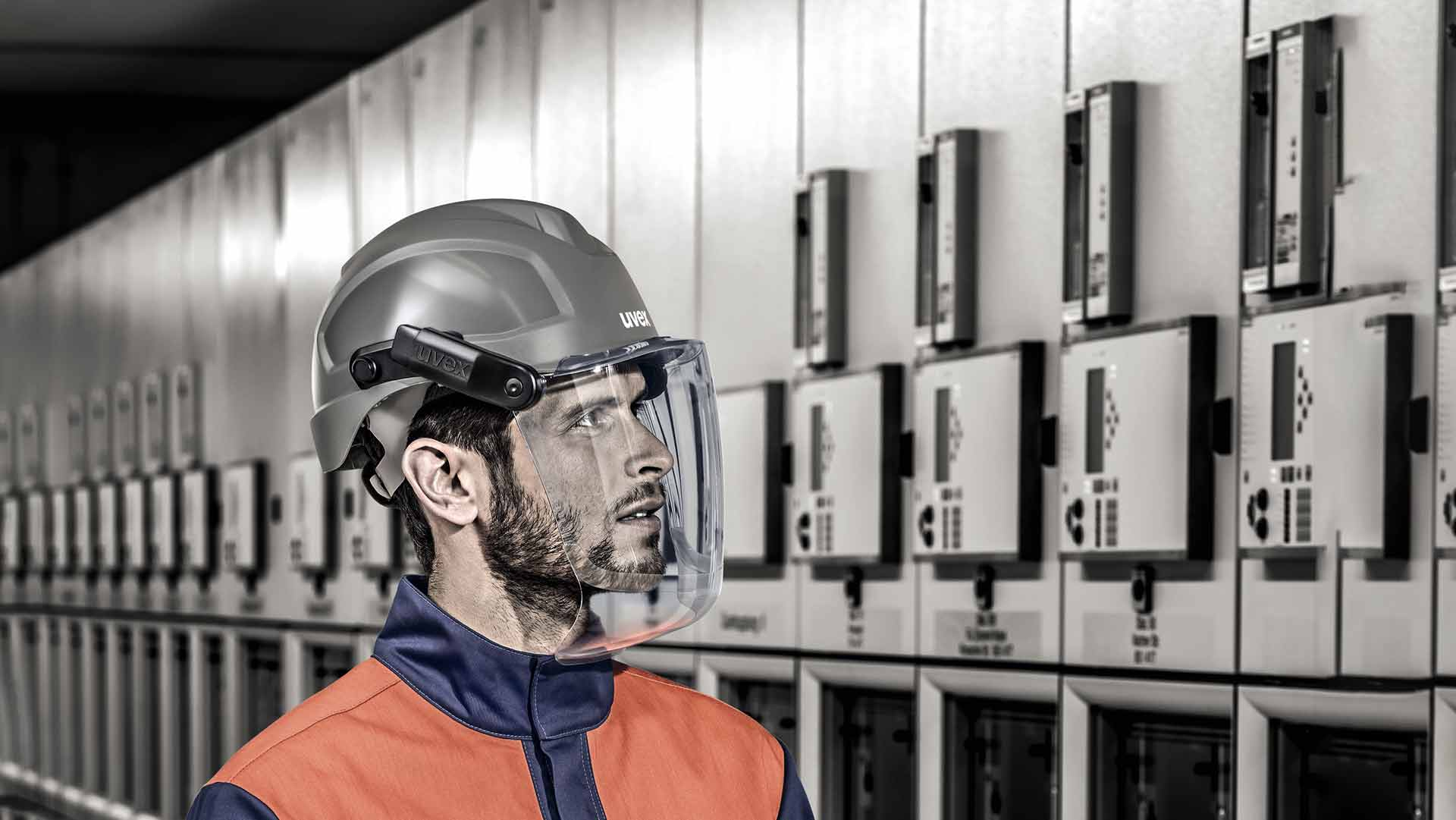 Male employee wearing uvex helmet and visor system