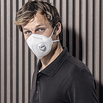 Male worker wearing uvex silv-Air respiratory protection