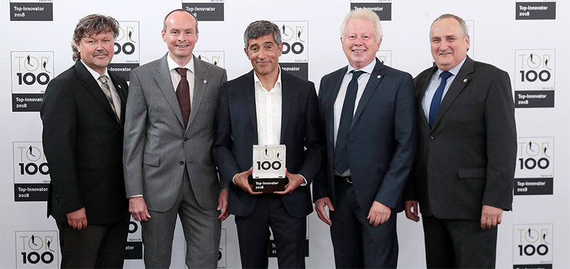 Company representatives celebrate the TOP 100 win for UVEX SAFETY GmbH & Co. KG