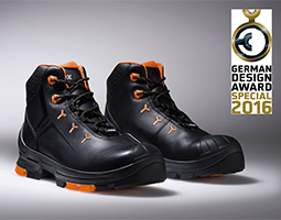 uvex 2 black and orange safety boots on grey background