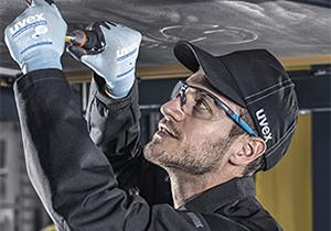 Male worker wearing uvex safety eyewear