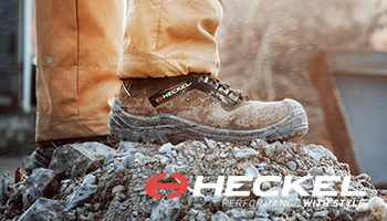 Heckel suxxeed offroad safety boot standing on gravel