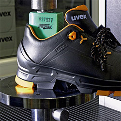 Testing of black and orange uvex 2 safety shoe
